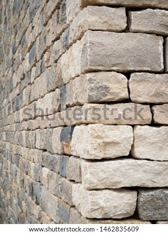 A close up of a stone textured external wall. Industrial background Zdjęcia stock ©
