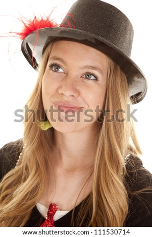 a close up of a teen girl in her top hat with a small smile on her face.