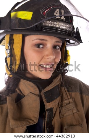 A close up of a woman firefighter with a smile on her face.