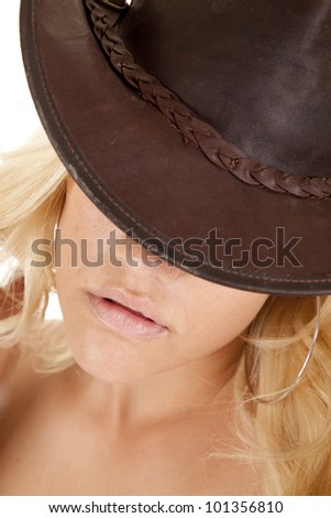a close up of a woman in her hat with her eyes being hid.