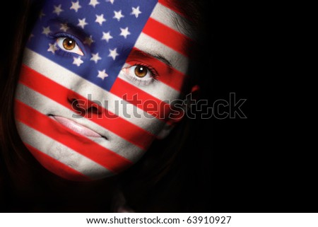 A close up of an american flag on a female face over dark background