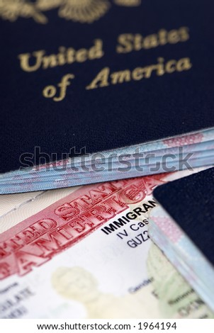 A close up of an Immigrant Visa and US passport