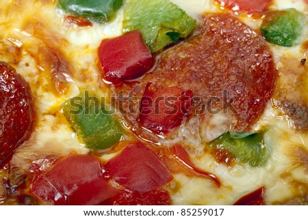 A close-up of an Italian pizza as an abstract food background. Pizza background.