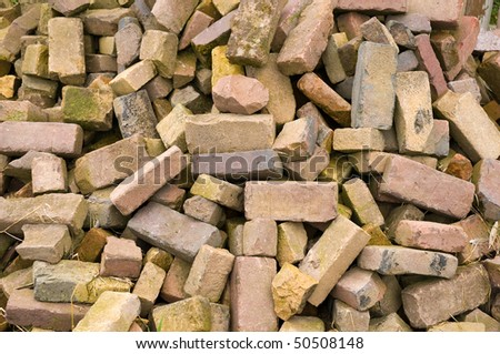 a close up of an old pile of bricks