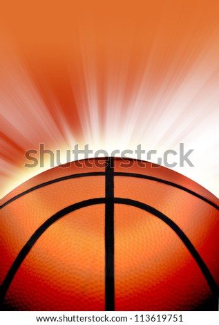 A close up of an orange basketball with glowing light rays shining on top with room at the top for a sport message.