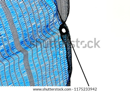 A close up of blue and black plastic shading net. #1175233942