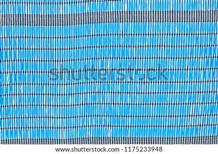 A close up of blue and black plastic shading net. #1175233948