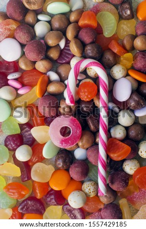 A close up of colorful bright assorted sweets and candy for kids party on white table, assortment of many candies  #1557429185