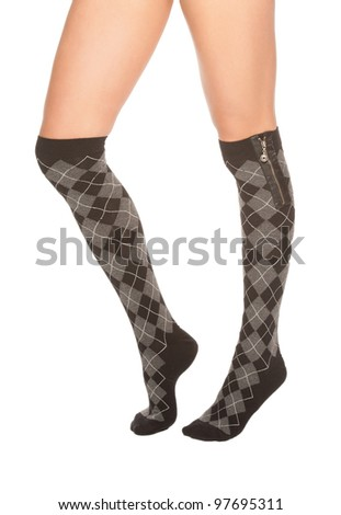 a close up of female legs with stockings