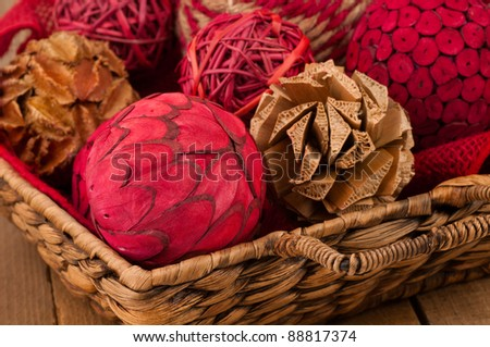 A Close Up of Festive Christmas Ornaments Made of Wood Fibers Arranged in a Wicker Basket and Used as Decoration for the Home with Room for Text or Your Words.
