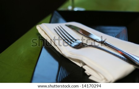 A close up of silverware on the dinner table