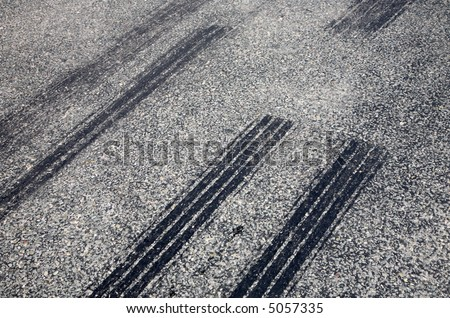 A close up of skid marks on a road.