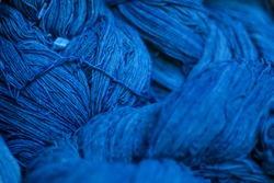 A close up of some deep blue cotton reels, Cotton dye indigo. Indigo is made from natural ingredients. in Thailand, cotton texture.
