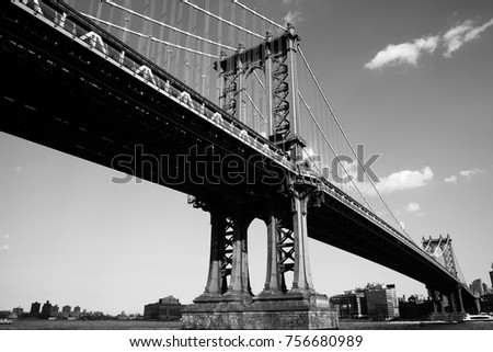 A close up of the iconic landmark, the Manhattan Bridge in black an white. #756680989