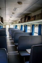 A close-up of the interior of an abandoned train passenger carriage seat
