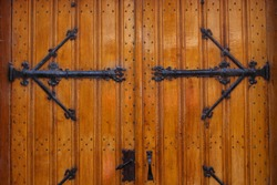 A close-up of the massive wooden doors of a church in Enkhuizen, The Netherlands