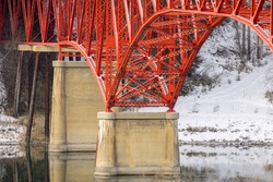 A close up of the support structure of a red bridge in Ione, Washington.