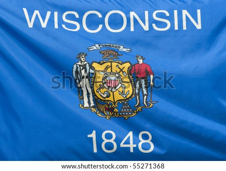 A close-up of the Wisconsin state flag waving in the wind.