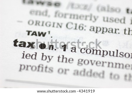 A close up of the word tax from a dictionary