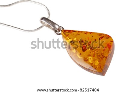 A close-up of triangular amber pendant