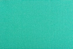 A close-up of turquoise fabric background texture