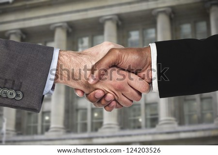 A close-up of two businessmen shaking hand