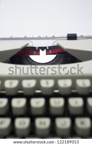 a close up of typewriter, focus on paper where message will be typed.