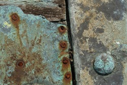 A close-up of weathered wood and corroded metal