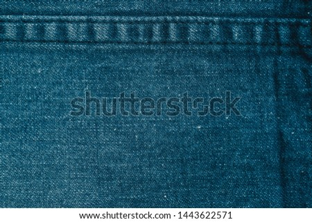 a close up of worn out unwashed Japanese engineered denim. in light Navy blue, with white hick