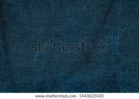 a close up of worn out unwashed Japanese engineered denim. in Navy blue, with colored hick