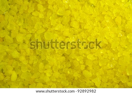 A close up of yellow crystal rocks.