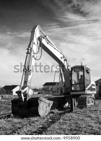 A close up on a big excavator. Added film grain for vintage look.