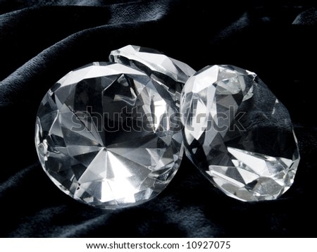A close up on a diamond on a dark background.