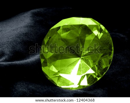 A close up on a Emerald jewel on a dark background. Shallow DOF.