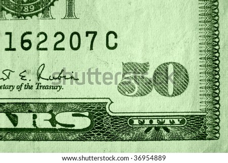 A close up on a fifty dollar bill. Shallow depth of field.