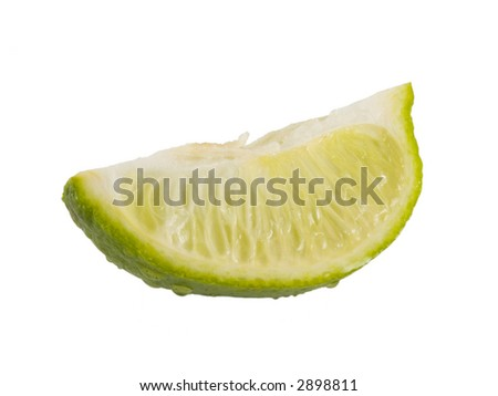 a close up on a fresh lime wedge isolated on a white background