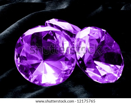 A close up on Amethyst jewels on a dark background. Shallow DOF.