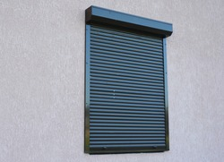 A close-up on house window with outdoor pvc roller blinds, motorized window roller shutters.