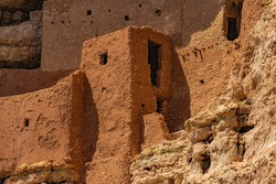 A close up on the windows and walls of Montezuma Castle National Monument, an ancient Sinagua cliff dwelling  in Camp Verde, Arizona, United States.