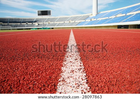 a close up photo of a sports stadium running track