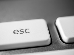 A close-up photo of the computer keyboard, the esc key.