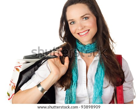A close-up portrait of a beautiful young woman shopping. Isolated on white.