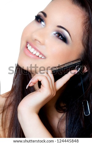 a close up portrait of a brunette beautiful girl talking on the phone