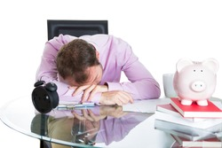 A close-up portrait of a businessman, corporate worker who fell asleep being exhausted working on his project whole day, isolated on a white background. Work place, desk, station.