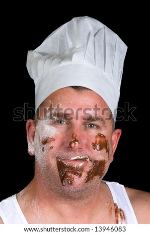 A close up portrait of a cook with sloppy dress and messy cake ingredients.