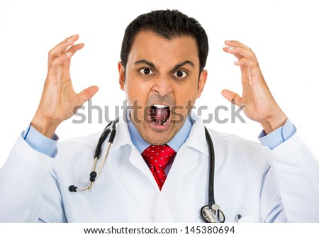 A close-up portrait of a rude, frustrated, upset doctor isolated on a white background