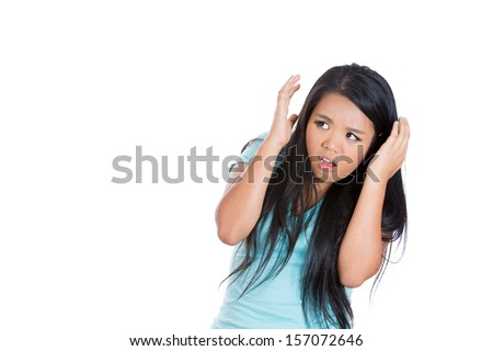 A close-up portrait of a scared , terrified lonely young woman raising hands up scared of something, isolated on a white background with copy space.
