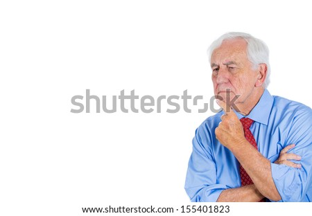 A close-up portrait of a senior executive, grandfather, deep in thought, looking troubled and concerned, sad, depressed, isolated on a white background with copy space. Human emotions, expressions.