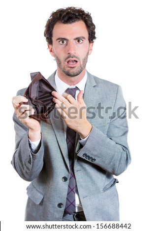 A close-up portrait of a shocked, surprised speechless man, businessman holding an empty wallet isolated on a white background. Bankruptcy financial difficulties concept. Job loss.