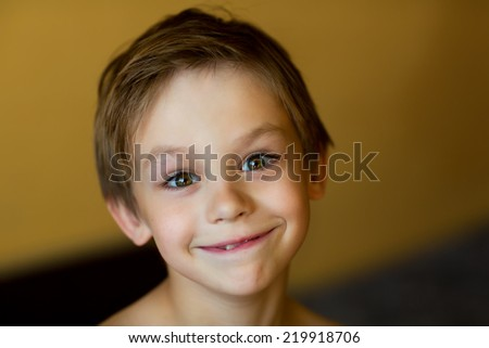A close up portrait of a smiling little boy with a pursy mouth #219918706